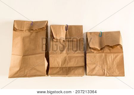 Brown paper bags on an off white background
