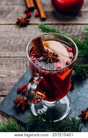 Holiday Hot Drink. Mulled Wine In Glass With Spices And Apple On Wooden Table Background. Christmas