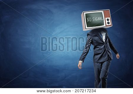 An unsteady businessman on blue background with a TV replacing his head and showing black screen and No Signal writing. No original thoughts. No brainer job. Business manipulation.