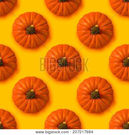 Halloween seamless pattern. Vector yellow Background with realistic pumpkins. Autumn illustration.