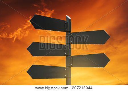 Blank metal road signpost, with sunset sky background