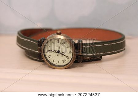 vintage watch on a green leather strap