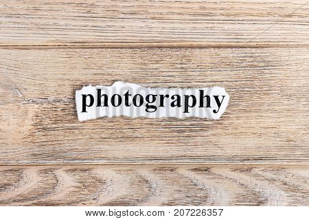 PHOTOGRAPHY text on paper. Word PHOTOGRAPHY on torn paper. Concept Image.
