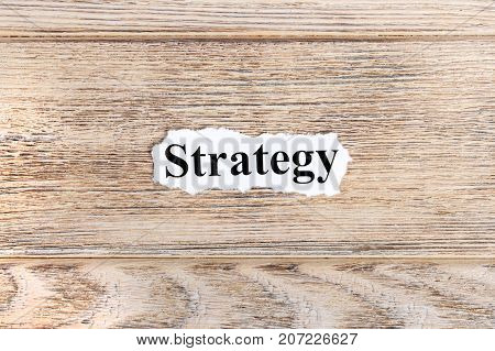 strategy text on paper. Word strategy on torn paper. Concept Image.