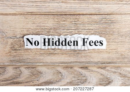 No hidden fees text on paper. Word No hidden fees on torn paper. Concept Image.