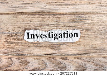 Investigation text on paper. Word Investigation on torn paper. Concept Image.