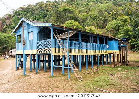 Boca de valeria Brazil - December 03 2015: hut on wooden piles in village in jungles on natural background. Poverty and dwelling concept.