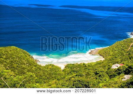 Blue sea or ocean water and green shore in Road Town UK. Seascape and mountain landscape top view. Summer vacation in paradise concept. Adventure and discovery. Travel destination and wanderlust