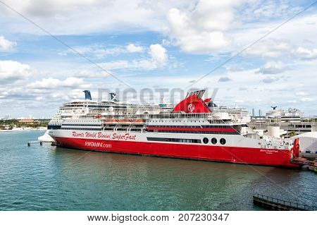Miami USA- January 1 2016: World resorts bimini super fast cruise liner in sea port on cloudy sky background in Miami USA. Ship tour and travelling. Summer vacation concept