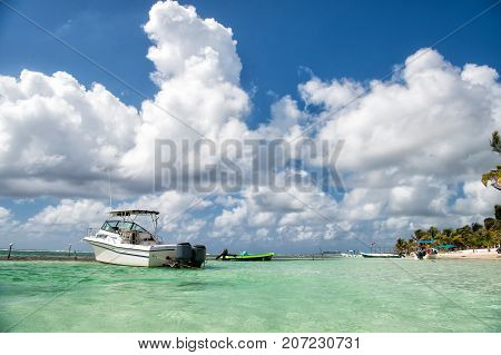 White Boat In Turquoise Sea In Costa Maya, Mexico