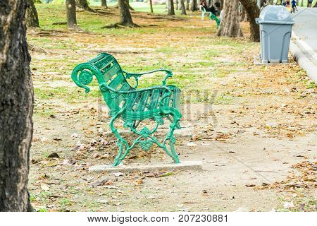 Green steel chair in the garden is a chair for guests after a walk in the garden.