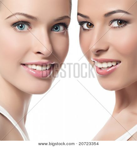 two attractive smiling women  on white background