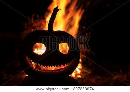 malicious grin pumpkin head with a fire in the background , Halloween, fear and aggression