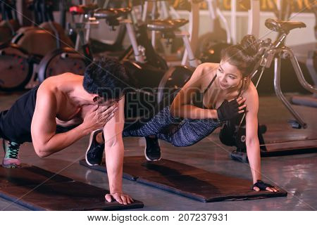 Two Asian People Sporty Put Your Hands On The Floor And Hold The Shoulder For Fitness Workout.