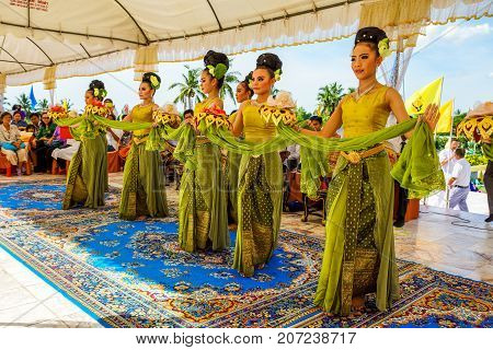 Angthong Thailand - July 15 2014: Woman dancers performing Thai tradition culture dancing to celebrate Buddhism event at Wat Muang Buddhist temple in Angthong Thailand