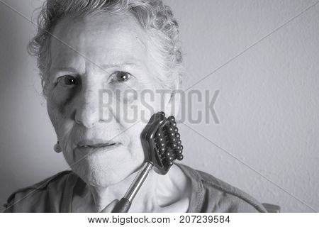 Older Woman Self Massaging With Small Massager