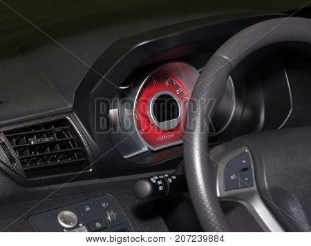 Modern car tachometer with red illumination. Closeup of dashboard a car