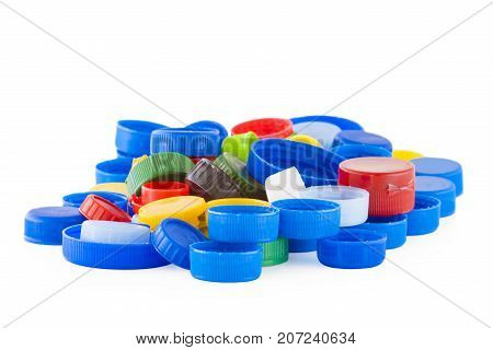 Color plastic bottle caps isolated on white background
