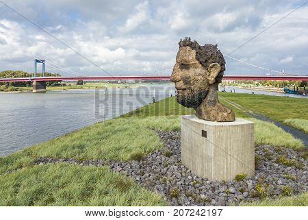 DUISBURG , GERMANY - OCTOBER 03 2017 : The sculpture Echo of the Poseidon created by Markus Lueppertz is greeting all mariners on the mercator island