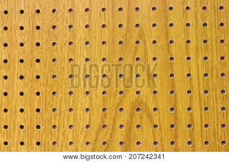 Chipboard texture with holes - pattern yellow color and dark holes