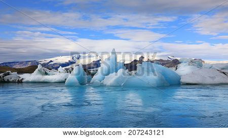 Amazing view of floating icebergs in the glacial lake Jokulsarlon at sunset Iceland