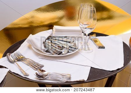 Clean Cutlery In Restaurant, Free Space. Forks, Spoons, Knives, Napkins And Wine Glasses On Tray On