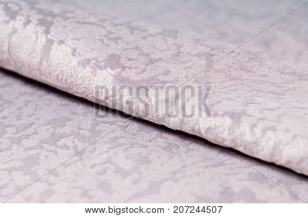 Beige collection of colorful velour textile samples. Fabric texture background