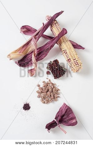 Black glutinous corn components on white table including kernels dried peels feather powder and dehydrated corn cobs that can used to a wide range. Zero-waste kitchen and cooking concept
