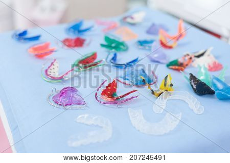 Dental braces or teeth retainers on table in dental clinic. Dental care and beautify concept