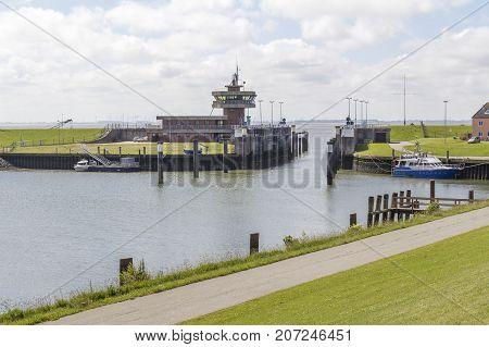watergate near Buesum around Dithmarschen in Schleswig-Holstein located in Germany