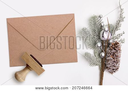 Christmas, Xmas rubber stamp and kraft envelope. Mockup for winter holiday products.