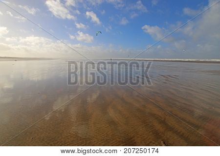Clouds reflected in Saunton Sands beach in Devon