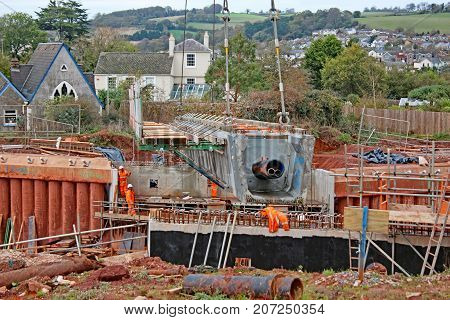 Concrete bridge beam being laid on a new road
