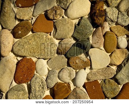 beautiful pebbles decorate the fence white, zen