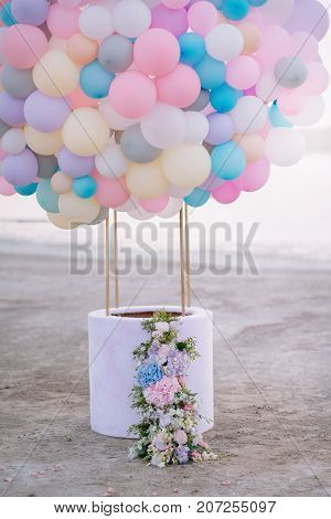 aerostat from balloons with a basket decorated with flowers