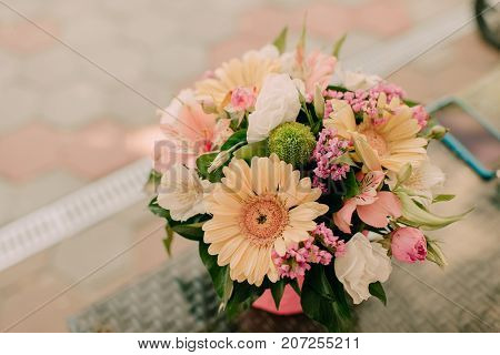a vase with flowers on the table