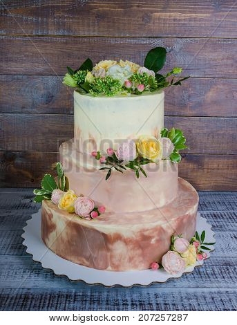 Three-tiered Wedding Ombre Cake Decorated With Roses And Greenery