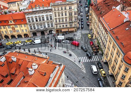 View of the cobblestone street in Prague from the top of St Nicholas Bell Tower.