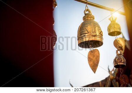 Small bell for pray decorate around Thai buddha temple with sunrise at Doi suthep landmark for tourist in Chiang Mai province Thailand