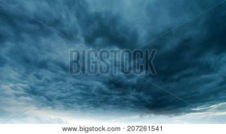 Dramatic rainy sky and dark clouds. Hurricane wind