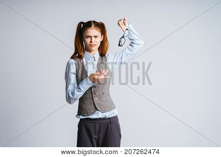 A girl in a suit, a schoolgirl, do not like glasses for sight, does not want to wear