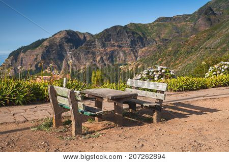 Outdoor Benches And Table In Mountain Village