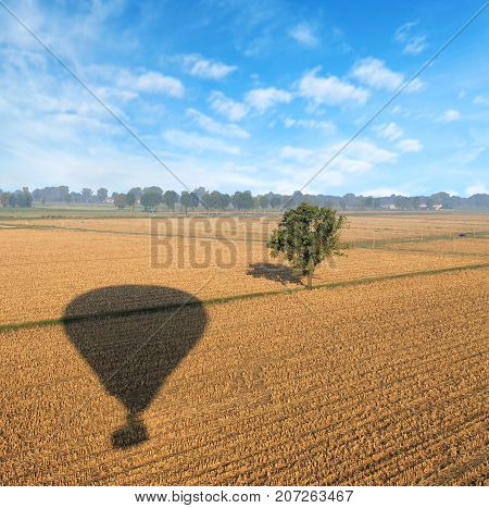 The Shadow Of A Balloon In The Field