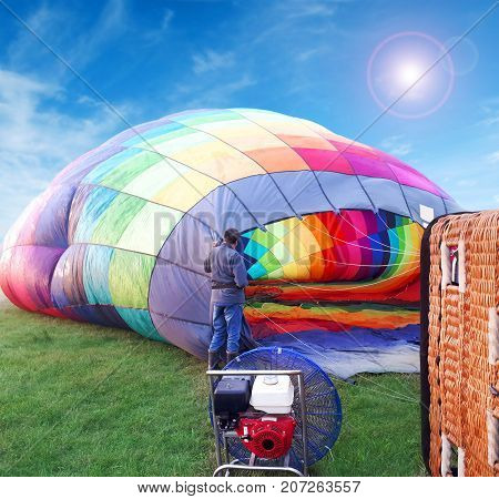 Multi Colored Hot Air Balloon In A Field