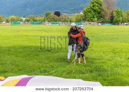 Interlaken Switzerland - May 26 2016: Tandem paraglider after landing in Interlaken Switzerland.