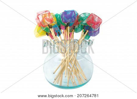 Colorful fish net scoops in glass blow . Fishing equipment