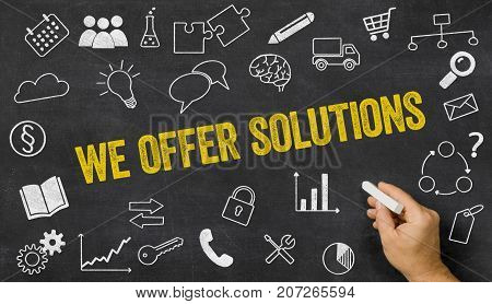 We Offer Solutions Written On A Blackboard With Icons