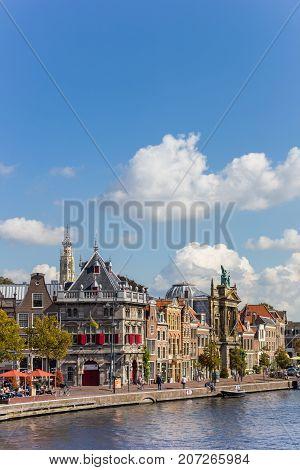 HAARLEM, NETHERLANDS - SEPTEMBER 03, 2017: Historic buildings at the Spaarne canal in Haarlem Netherlands