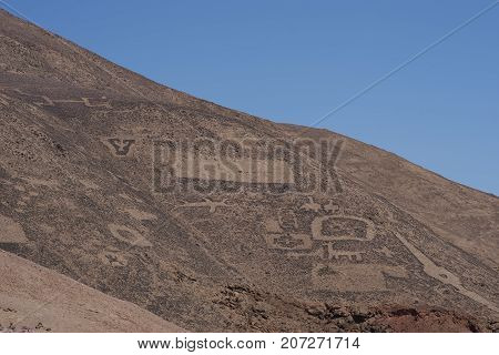 Large group of ancient petroglyphs on the hillsides at Cerro Pintados in the Atacama Desert in the Tarapaca Region of northern Chile.