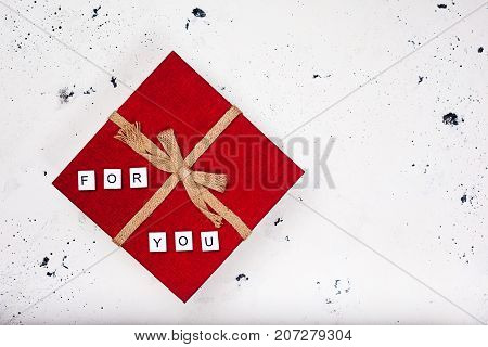 Vintage red gift box with text For You on white background. Top view